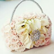 Handbag bridal bouquet of roses and callas
