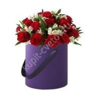 Roses with freesias in a hatbox