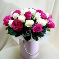 White and pink roses in a hatbox