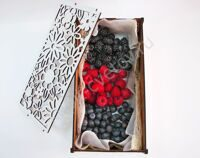 Casket with raspberries, blackberries and blueberries