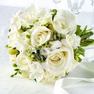 Wedding bridal bouquet of white roses and freesias
