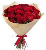 Red roses in kraft packaging