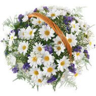 Basket of cornflowers and daisies